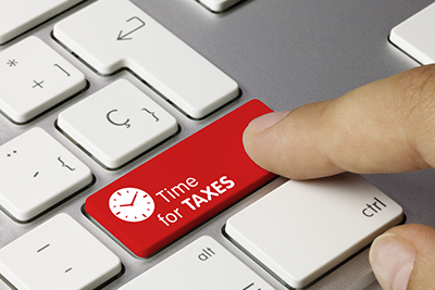 Depiction of tax time button on keyboard