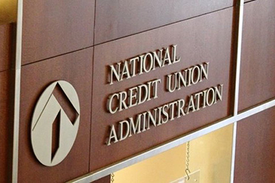 Picture of the National Credit Union Administration logo on building