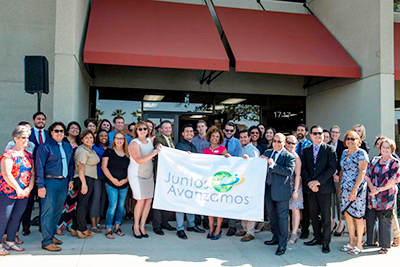 """Credit union and local officials gather together during the """"Juntos Avanzamos"""" inauguration event at Kern FCU in mid-May. Kern FCU is the seventh credit union in California to gain this designation by the National Federation of Community Development Credit Unions."""