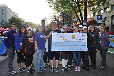 Credit union officials, business partners, and representatives from UC Davis Children's Hospital and UCSF Benioff Children's Hospital Oakland, and the Sacramento Running Association at the 2018 Credit Union SacTown Run. This year's event raised more than $235,000 for Children's Miracle Network Hospitals in California and Nevada.
