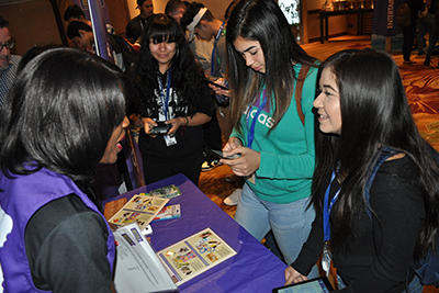 "L-R: Amistad High School students Cheyenne Chapa, 16, and Angelina Moran, 16, learn about budgeting and making real-life financial choices at the ""Bite of Reality"" event before the REACH 2017 annual convention."