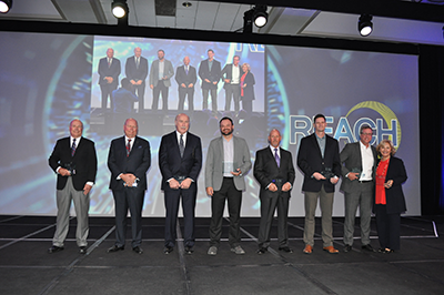 """PAC award winners on stage during the second day of the """"REACH 2017"""" annual convention."""